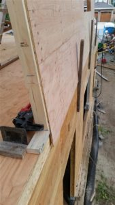"""Cleats kept upper wall from sliding off deck as it was raised. This was even more important as the sheathing on the upper walls extended 5"""" down the lower walls to tie the upper wall assemblies together to the rim boards."""