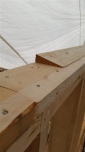 Sloped top plates provide bearing for truss
