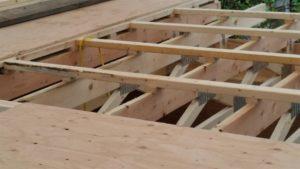 "Cross Purlin held off truss by 1"" plywood block"