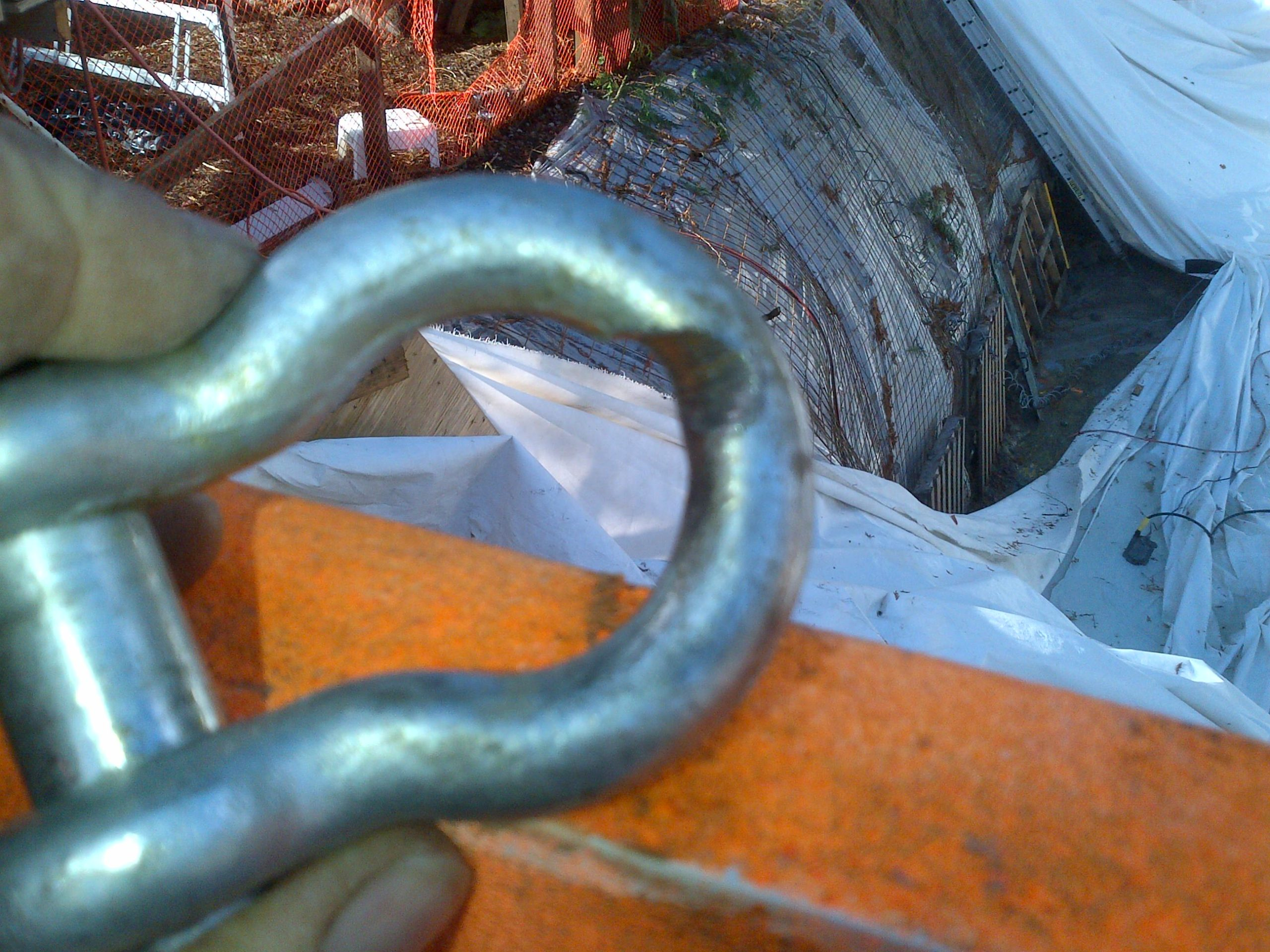 Shackle was cut about 25% of the way through.  Was only a matter of time before it failed.