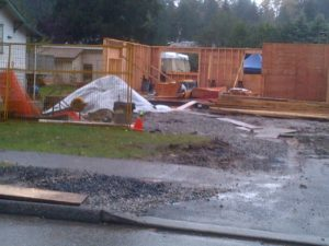 Raining so hard even the pros were absent.  Notice the unprotected pile of plywood warping in the rain.