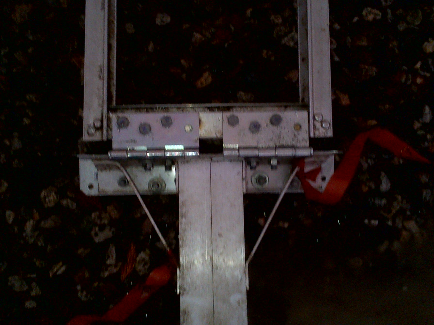 Strong hinges were bolted to both the angle iron and original frame.