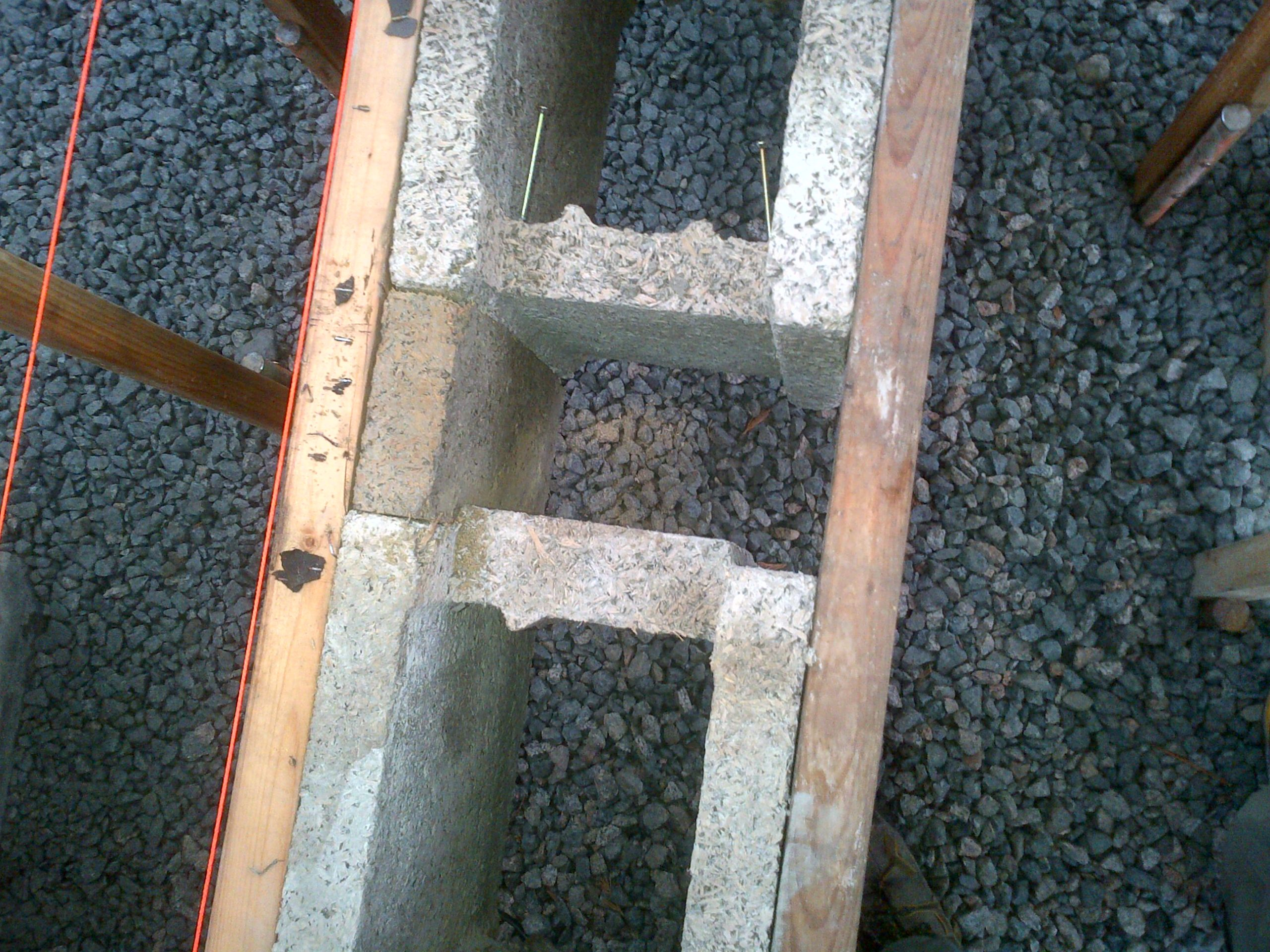Step 2 - Cut side panels from a cut-off or broken block and insert and secure with screws