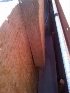 Shorter inboard ROCKWOOL panel secured with fishing line.