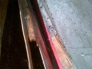 Plywood delaminated and 'bubbled' allowing the concrete to flow between the laminate layers.