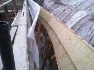 Only mildly difficult part of removing forms was on the outboard side of the west wall.  The vertical supports were also used to splice the plywood sheets together (plywood was screwed to supports from inside the form).  This meant I could not remove the uprights until the form had been pealed off the foundation.  But this left the form and the insulation inserts dangling 12ft into the air.  Made for some great jungle gym antics to disassemble!