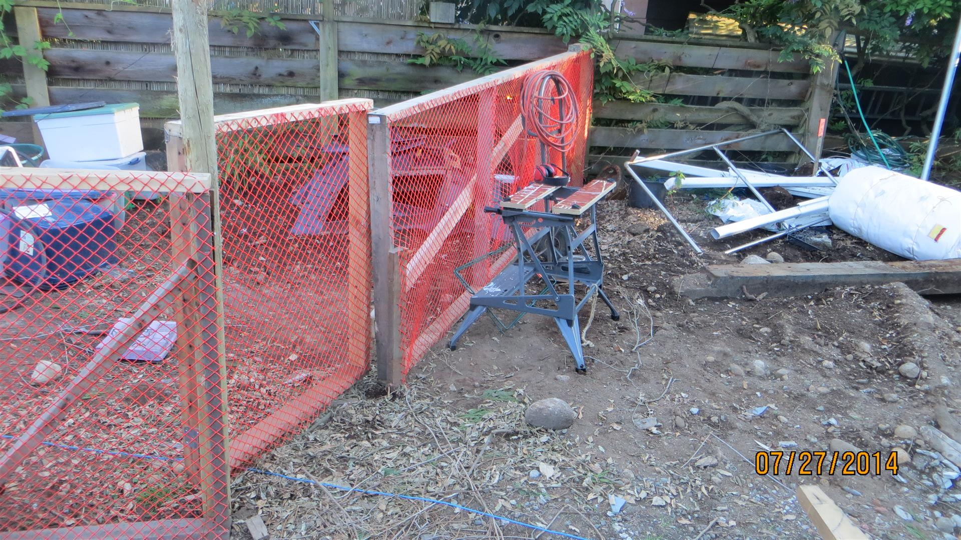 Final tree fencing panel and gate installed.