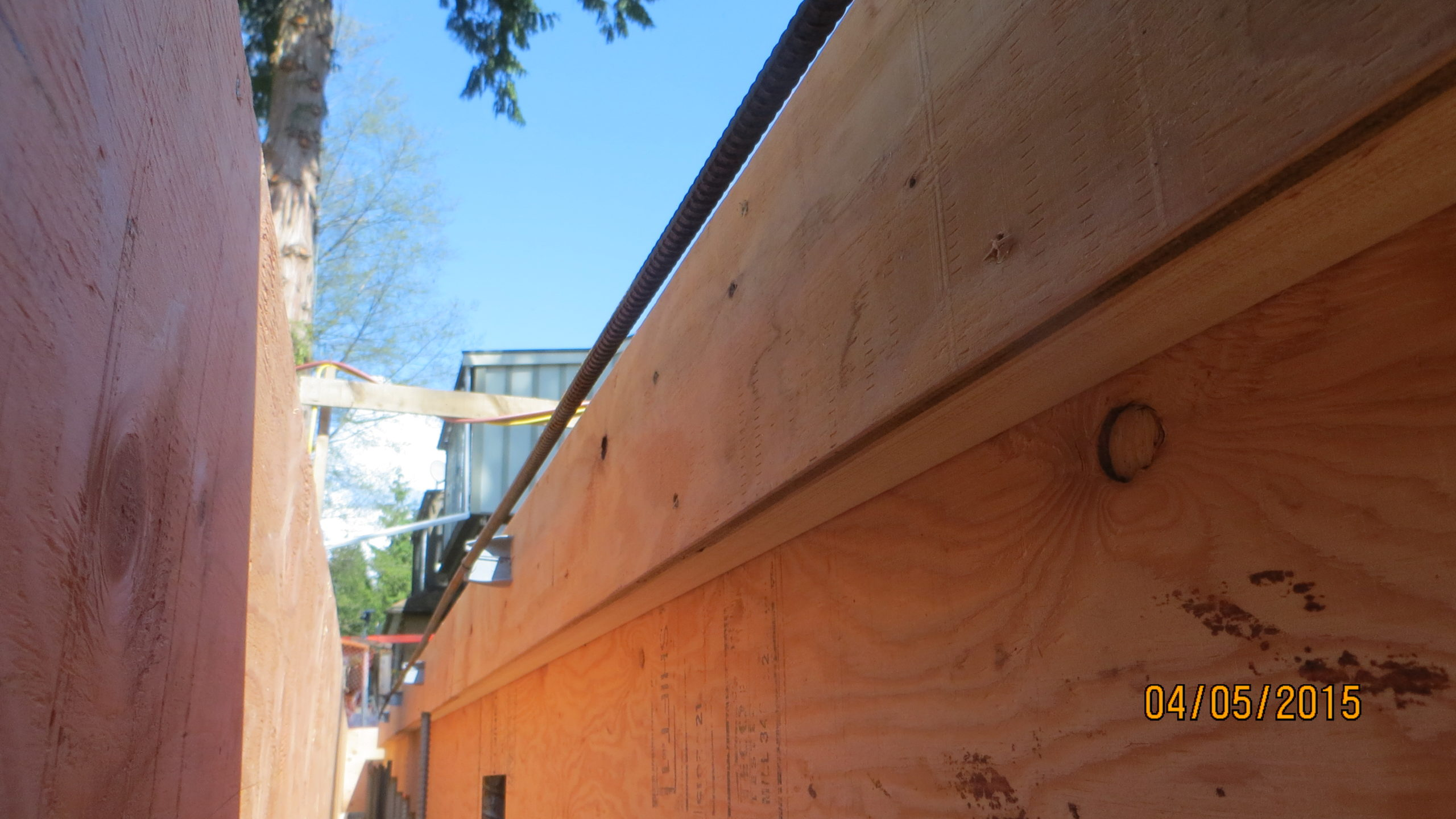 "One of the functions of the formed upper curb was to create a bump-out flush with the top of the floor trusses to provide an extra 2"" of floor space and ensure that the drywall lined up with the framed wall above."