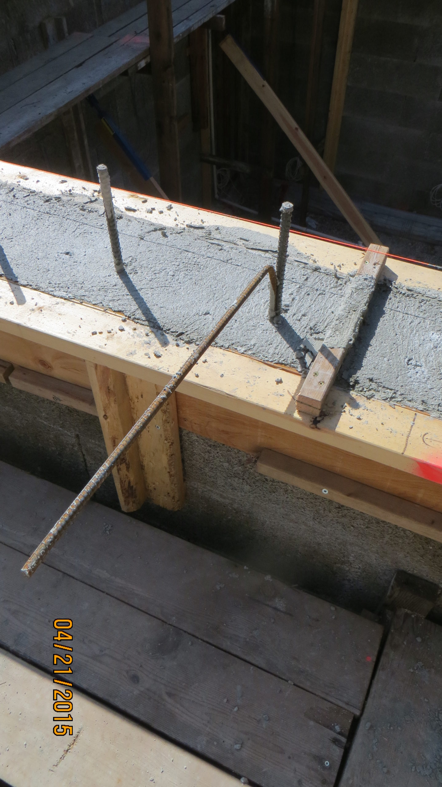 Something else that I 'prepped' was to attach the bend dowels for the garage suspended slab to the ICF vert bars at the right height.  This allowed them to just be 'swung out' once the pour was complete, but the concrete was still wet enough.  I checked all this morning and all were well secured.