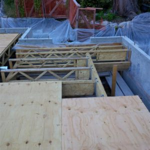 With all trusses and beams in place around stair, decking can proceed.