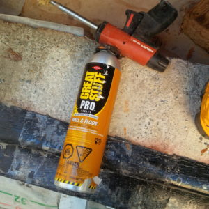 Great Stuff Foam Adhesive.