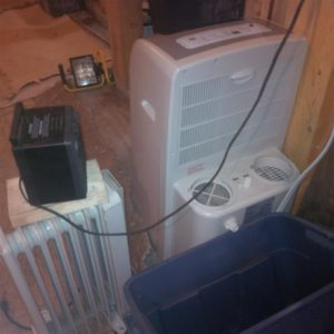Started out with my portable air conditioner that has a dehumidification setting.  But the basement was too cold for that setting to kick on and I would have had to have the cube heater pre-heating the intake air wasting the heat from the cube heater (would still come out of the unit colder than surrounding air temp).