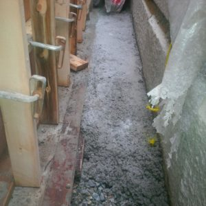 shovelled wet concrete off to the side of the north wall